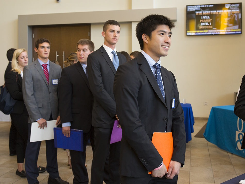 business professionals standing in line